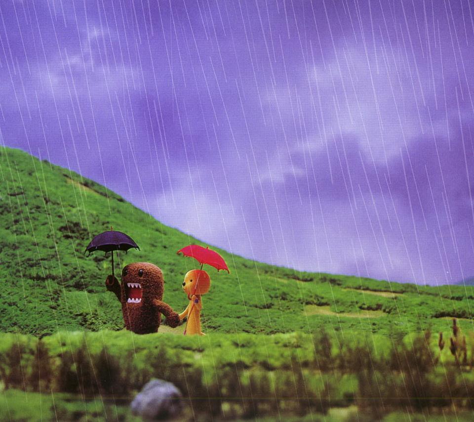 たーちゃんと雨の日に歩いているどーもくんです。
